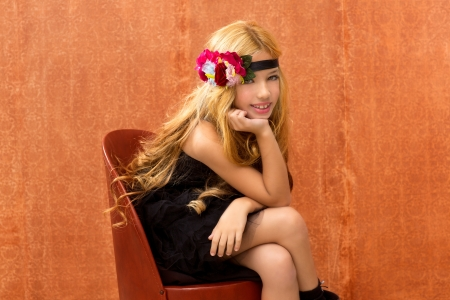 blond fashion kid girl sitting on retro vintage seat and background photo