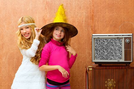 children 70s two kid friend girls in party with retro wood tv photo