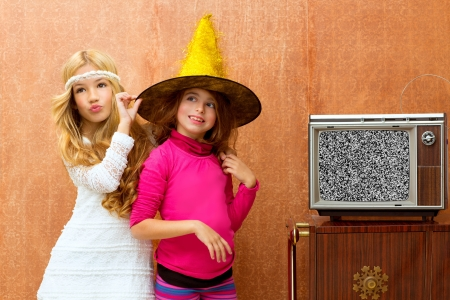 children playing together: children 70s two kid friend girls in party with retro wood tv
