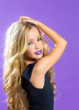 modern doll: Blond children fashiondoll girl fashion makeup on purple background