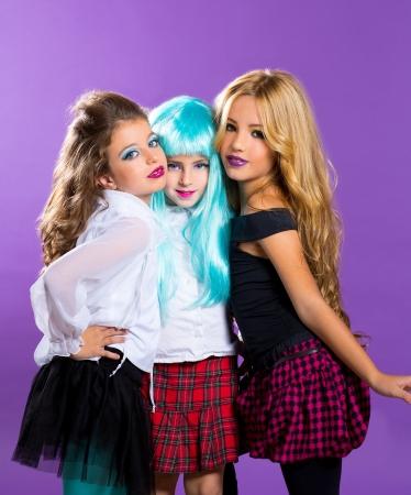 blonde little girl: children group of fashiondoll friends fashion happy girls on purple Stock Photo