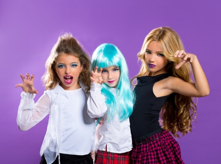children group of fashiondoll friends scaring gesture girls on purple photo