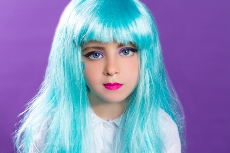 Children girl with blue turquoise long wig as fashiondoll on purple photo