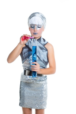fantasy makeup: children futuristic fashion children silver girl doing chemical laboratory experiment