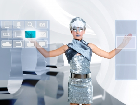 futuristic children girl in silver touch finger copyspace glass holographic screen photo