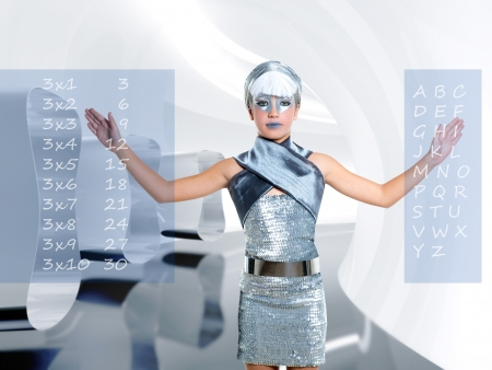 technologic: futuristic children girl in silver touch finger maths and abc at future school with holographic screen Stock Photo