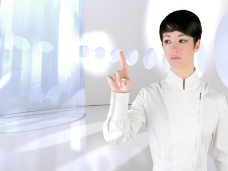 holographic: Futuristic woman touch finger copyspace in modern indoor Stock Photo