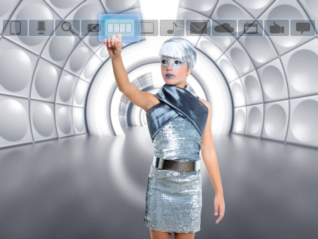 touch screen hand: futuristic kid girl in silver touching finger icons on glass transparent holographic screen Stock Photo