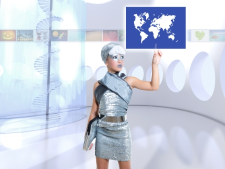futuristic children girl in silver touch finger world map glass screen photo