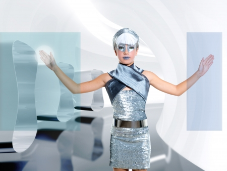 technological: futuristic children girl in silver touch finger copyspace glass holographic screen Stock Photo