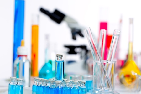 Pharmaceutical research: Chemical scientific laboratory stuff microscope test tube flask pipette Stock Photo
