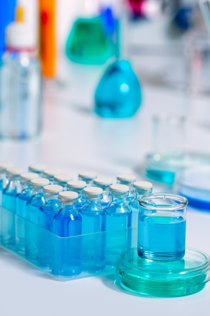Chemical scientific laboratory stuff test tube and blue glass bottles photo