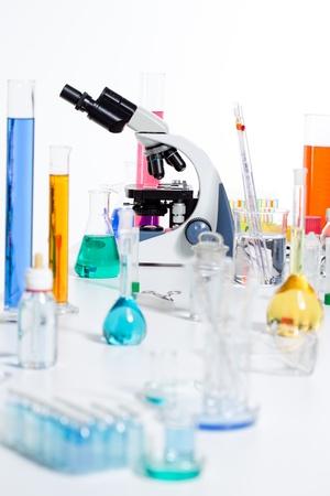 drug discovery: Chemical scientific laboratory stuff microscope test tube flask pipette Stock Photo