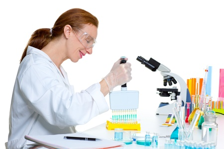 chemical laboratory scientist woman working with multi channel pipette Stock Photo - 16651326