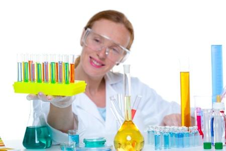 chemical laboratory scientist woman looking at test tube Stock Photo - 16651319