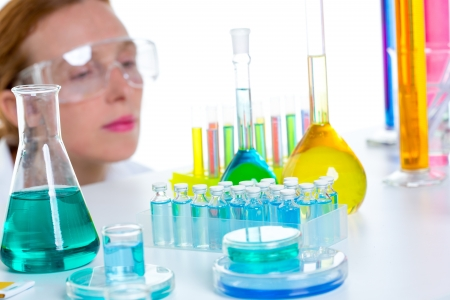 chemical laboratory scientist woman working with test tubes and flask Stock Photo - 16650664