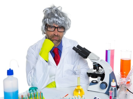 Carzy pensive nerd scientist at chemical laboratory thinking with microscope Stock Photo - 16651318