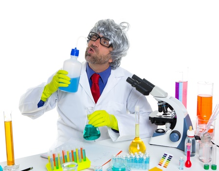 Crazy silly nerd scientist drinking chemical experiment liquid at laboratory Stock Photo - 16708953