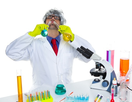 Crazy silly nerd scientist drinking chemical experiment liquid at laboratory Stock Photo - 16650886