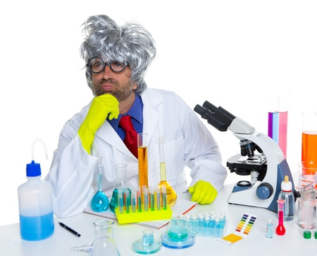 Carzy pensive nerd scientist at chemical laboratory thinking with microscope Stock Photo - 16651434