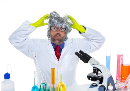 Crazy mad nerd scientist funny expression at laboratory on chemical experiment Stock Photo - 16651329