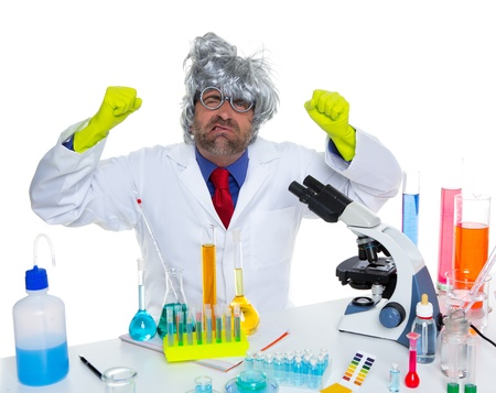 Crazy mad nerd scientist funny expression at laboratory on chemical experiment Stock Photo - 16709008