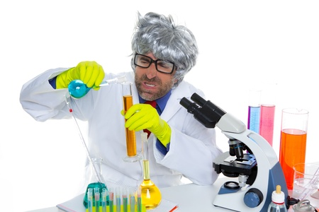 Crazy mad nerd scientist funny expression at laboratory on chemical experiment Stock Photo - 16709193