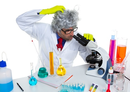 Crazy mad nerd scientist at laboratory microscope thinking gesture Stock Photo - 16651228