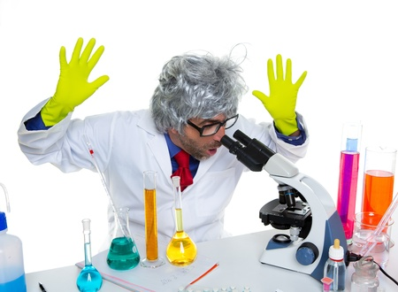 Crazy mad nerd scientist at laboratory microscope surprised expression Stock Photo - 16709152