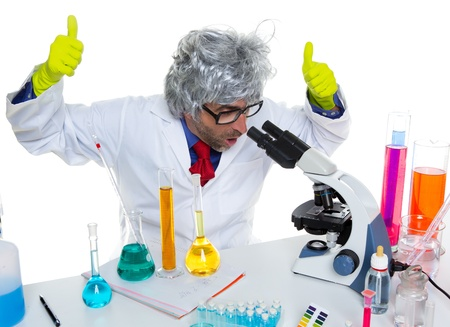Crazy mad nerd scientist at laboratory microscope ok hand sign gesture Stock Photo - 16651278