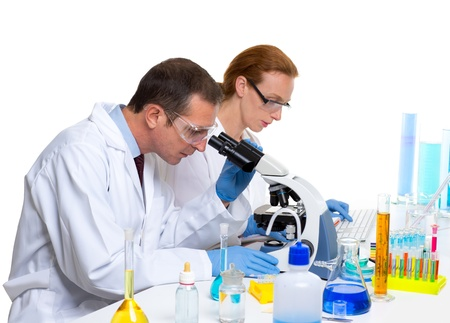 laboratory with two scientist working with test tubes flask and microscope Stock Photo - 16651348