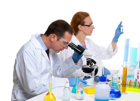 chemical laboratory with two scientist working with test tubes and microscope Stock Photo - 16709140