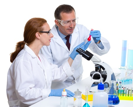 laboratory with two scientist working with test tubes flask and microscope Stock Photo - 16651471