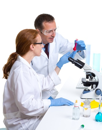 chemical laboratory with two scientist working with test tubes and microscope Stock Photo - 16651379