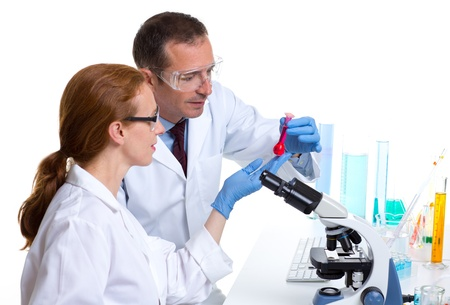 laboratory with two scientist working with test tubes flask and microscope Stock Photo - 16651314