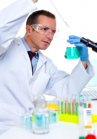 laboratory scientist working at lab with test tubes and microscope Stock Photo - 16649163