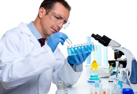 laboratory scientist working at lab with test tubes and microscope Stock Photo