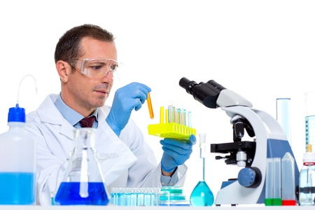 laboratory scientist working at lab with test tubes and microscope photo