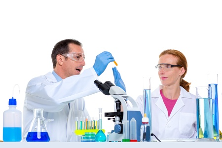 laboratory with two scientist working with test tubes flask and microscope Stock Photo - 16650691