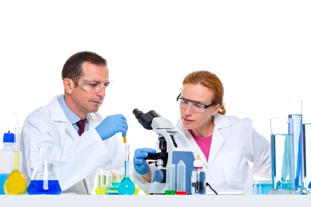 chemical laboratory with two scientist working with test tubes and microscope photo
