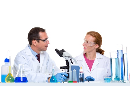 laboratory with two scientist working with test tubes flask and microscope Stock Photo - 16648427