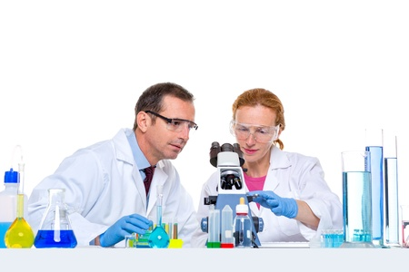 laboratory with two scientist working with test tubes flask and microscope photo
