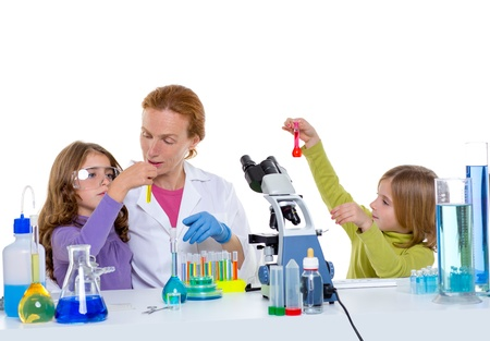 children girls and teacher woman at laboratory on school chemical class Stock Photo - 16708972