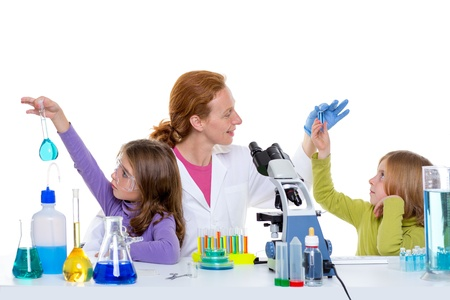 children girls and teacher woman at laboratory on school chemical class photo