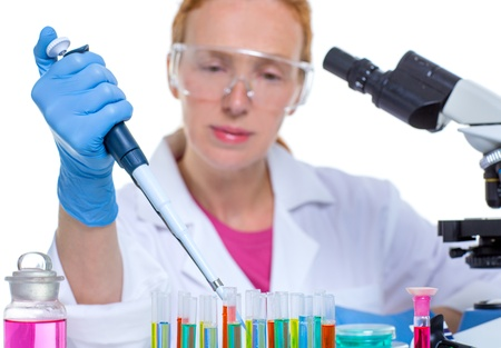 chemical laboratory scientist woman working with pipette and test tubes photo