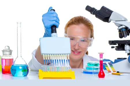 chemical laboratory scientist woman working with multi channel pipette Stock Photo - 16651095