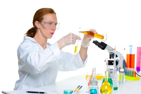 chemical laboratory scientist woman looking at test tube Stock Photo - 16663924