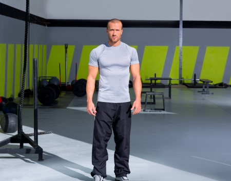Fitness man at gym standing with crossfit stuff photo
