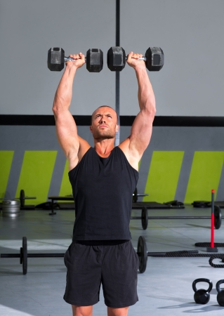 Gym man with dumbbells weights lifting exercise crossfit fitness workout Stock Photo - 17050639