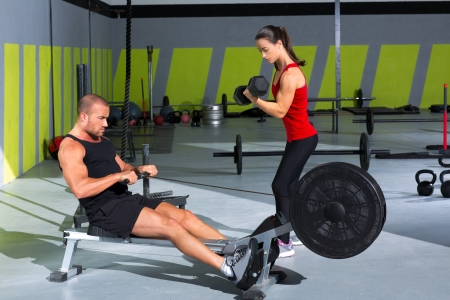 Gym couple with dumbbell weights and fitness power workout photo